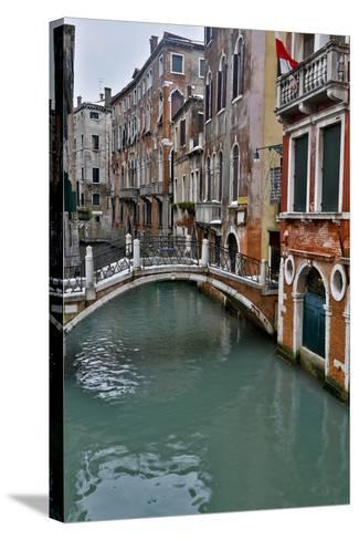 Venice, Italy. Canal with Arched Bridge-Darrell Gulin-Stretched Canvas Print