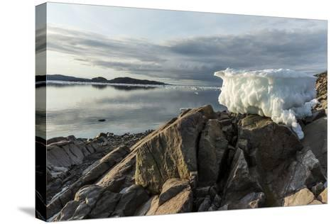 Canada, Nunavut, Iceberg Stranded by Low Tide Along Frozen Channel-Paul Souders-Stretched Canvas Print