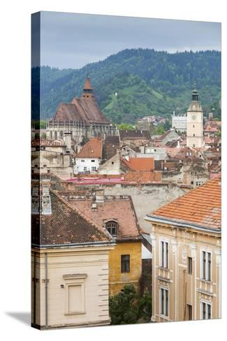 Romania, Transylvania, Brasov, City with Black Church and Town Hall-Walter Bibikow-Stretched Canvas Print