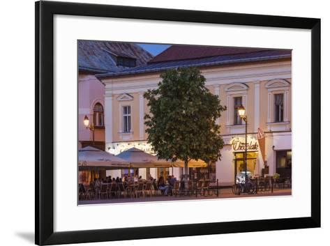 Romania, Baia Mare, Piata Libertatii Square, Outdoor Cafes, Dusk-Walter Bibikow-Framed Art Print