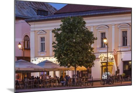 Romania, Baia Mare, Piata Libertatii Square, Outdoor Cafes, Dusk-Walter Bibikow-Mounted Photographic Print