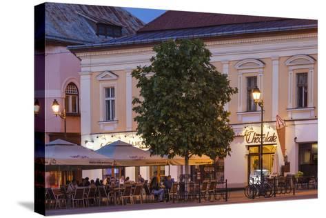 Romania, Baia Mare, Piata Libertatii Square, Outdoor Cafes, Dusk-Walter Bibikow-Stretched Canvas Print