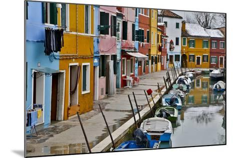 Boats Docked Along Canal with the Colorful Homes of Burano, Italy-Darrell Gulin-Mounted Photographic Print