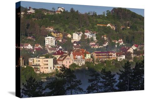 Romania, Transylvania, Brasov, Town Buildings in Fog, Dawn-Walter Bibikow-Stretched Canvas Print