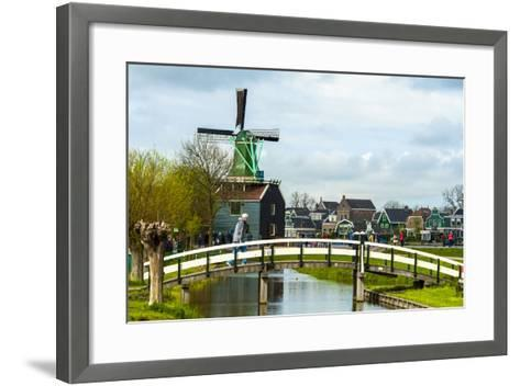 A Bridge Leading to a Village of Historic Homes in the Netherlands-Sheila Haddad-Framed Art Print