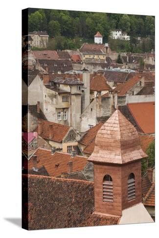 Romania, Transylvania, Brasov, Elevated View of Town Buildings-Walter Bibikow-Stretched Canvas Print