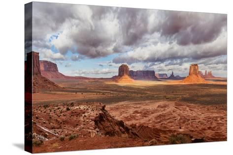 USA, Arizona, Monument Valley, under Clouds-John Ford-Stretched Canvas Print