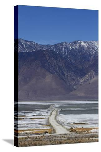 Road across Owens Lake and Sierra Nevada Mountains, California-David Wall-Stretched Canvas Print