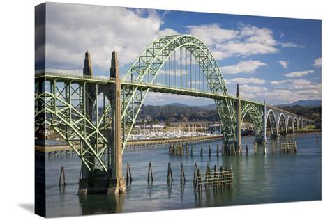 Yaquina Bay Bridge over the Harbor and Marina at Newport, Oregon, USA-Brian Jannsen-Stretched Canvas Print