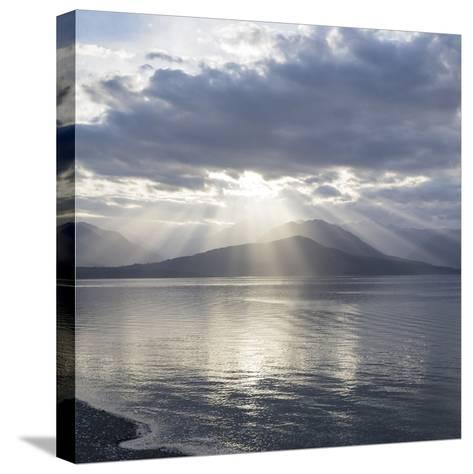 Washington State, Seabeck. Composite of God Rays over Hood Canal-Don Paulson-Stretched Canvas Print