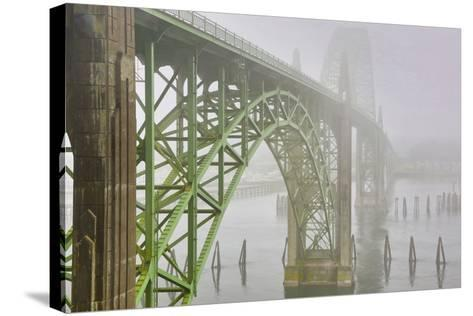 USA, Oregon. Yaquina Bay Bridge in Fog-Jean Carter-Stretched Canvas Print
