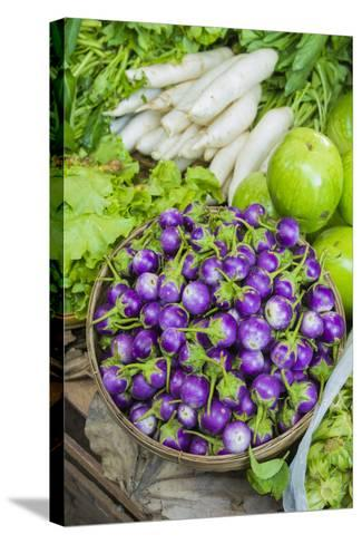 Myanmar. Bagan. Nyaung U. Market. Eggplant for Sale in the Market-Inger Hogstrom-Stretched Canvas Print