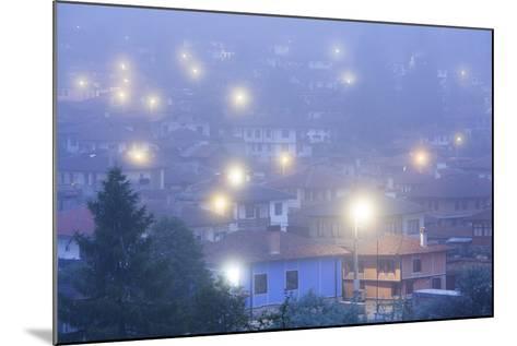 Bulgaria, Central Mountains, Koprivshtitsa, Village in Morning Fog-Walter Bibikow-Mounted Photographic Print
