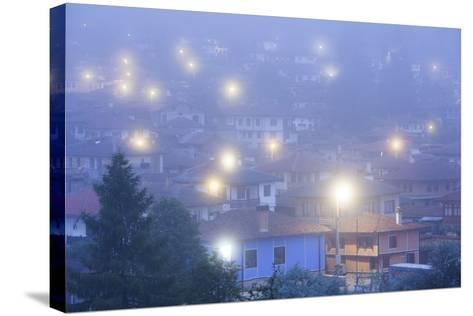 Bulgaria, Central Mountains, Koprivshtitsa, Village in Morning Fog-Walter Bibikow-Stretched Canvas Print