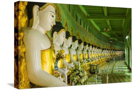 Myanmar. Mandalay. Sagaing Hill. Thirty Caves Temple. Row of Buddhas-Inger Hogstrom-Stretched Canvas Print