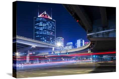 China, Beijing, Highway Overpass and Skyscrapers Along Third Ring Road-Paul Souders-Stretched Canvas Print
