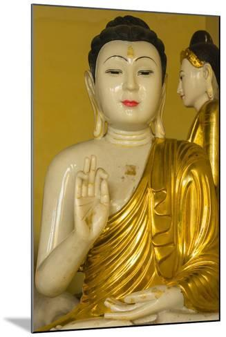 Myanmar. Yangon. Shwedagon Pagoda. Buddha in the Discussion Mudra-Inger Hogstrom-Mounted Photographic Print