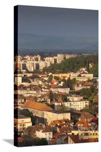 Romania, Transylvania, Brasov, New City Buildings, Sunset-Walter Bibikow-Stretched Canvas Print