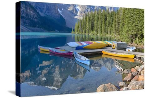 Canada, Banff NP, Valley of the Ten Peaks, Moraine Lake, Canoe Dock-Jamie & Judy Wild-Stretched Canvas Print