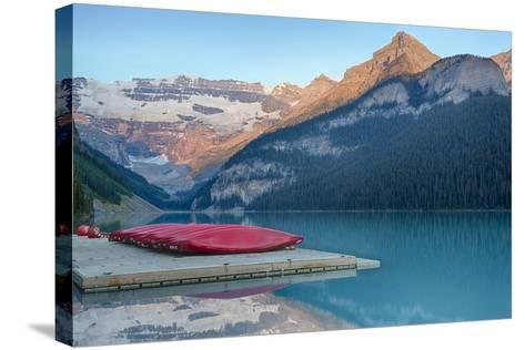 Canada, Banff NP, Lake Louise, Canoes at Boathouse Dock, Mt Victoria-Jamie & Judy Wild-Stretched Canvas Print
