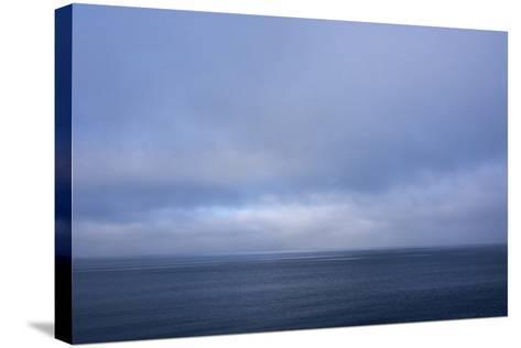 Norway. Svalbard. Nordaustlandet Island. Calm Water and Cloudy Skies-Inger Hogstrom-Stretched Canvas Print