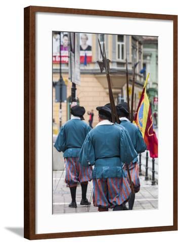 Romania, Transylvania, Brasov, Men Dressed Like Medieval Soldiers-Walter Bibikow-Framed Art Print