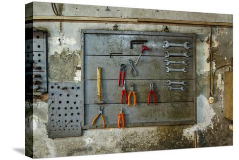 Tools on Wall in Old Repair Shop in Persembe Pazar, Istanbul, Turkey-Ali Kabas-Stretched Canvas Print