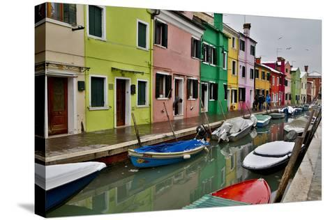Boats Docked Along Canal with the Colorful Homes of Burano, Italy-Darrell Gulin-Stretched Canvas Print