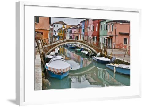 Boats Docked Along Canal with the Colorful Homes of Burano, Italy-Darrell Gulin-Framed Art Print