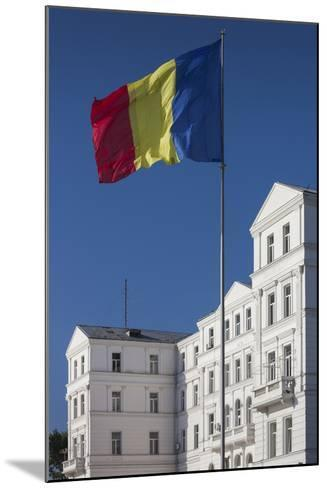 Romania, Black Sea Coast, Constanta, Flag and Government Building-Walter Bibikow-Mounted Photographic Print