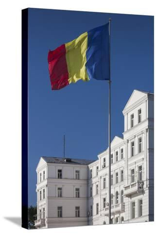 Romania, Black Sea Coast, Constanta, Flag and Government Building-Walter Bibikow-Stretched Canvas Print