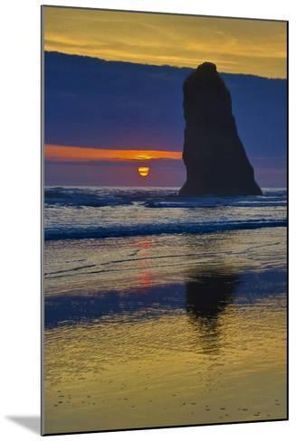 USA, Oregon, Cannon Beach. Sunset on Lone Seastack-Jean Carter-Mounted Photographic Print