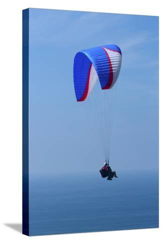 California, San Diego. Hang Glider Flying at Torrey Pines Gliderport-Steve Ross-Stretched Canvas Print