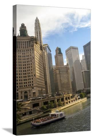 A Boat and Buildings Along the Chicago River, Chicago, Illinois, USA-Susan Pease-Stretched Canvas Print