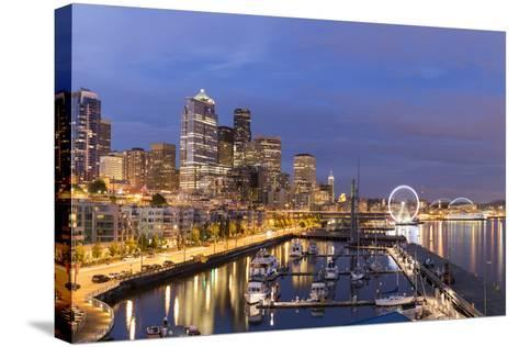 USA, Washington, Seattle. Night Time Skyline from Pier 66-Brent Bergherm-Stretched Canvas Print
