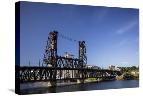 Oregon, Portland. Steel Bridge Spans the Willamette River-Brent Bergherm-Stretched Canvas Print