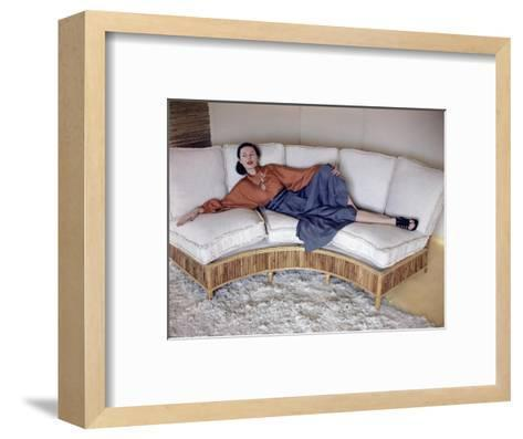 Model Reclining on Bamboo Couch--Framed Art Print