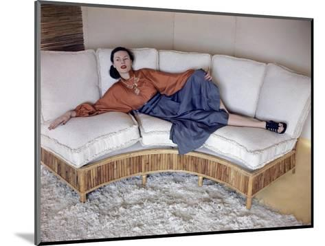 Model Reclining on Bamboo Couch--Mounted Premium Photographic Print