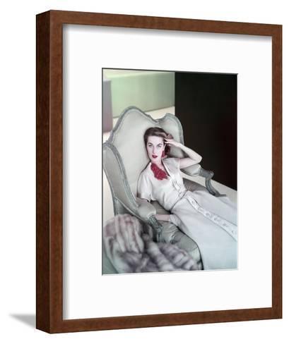 Model Reclining in a Chair Wearing Beige Dress of Slubbed Italian Silk with a Satin Closing--Framed Art Print