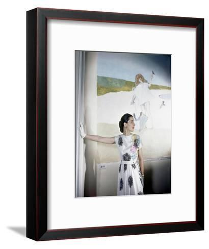 Model Standing before Mural by Vertes Wearing Floral Print on White Rayon Crepe Dress--Framed Art Print