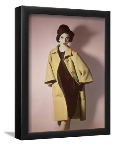 Duplicate of Model Wearing Bright Yellow Coat over Black Dress with Black Hat--Framed Art Print