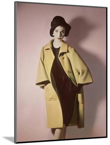 Duplicate of Model Wearing Bright Yellow Coat over Black Dress with Black Hat--Mounted Premium Photographic Print