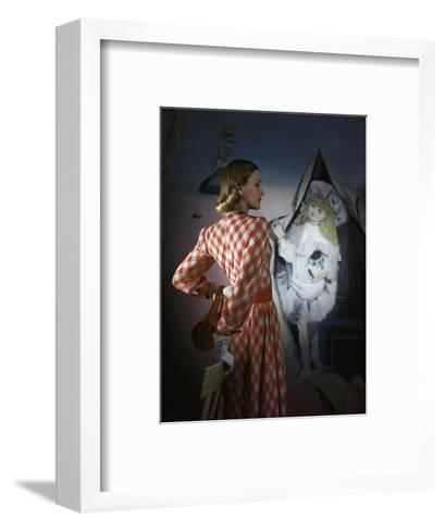 Model Standing before a Mural by Vertes Wearing a Red and White Lattice-Checked Rayon Crepe Dress--Framed Art Print