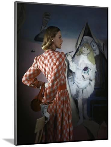 Model Standing before a Mural by Vertes Wearing a Red and White Lattice-Checked Rayon Crepe Dress--Mounted Premium Photographic Print