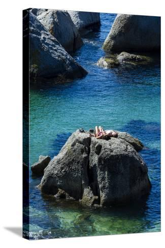 A Couple Sunbathing on a Boulder Above a Clear Blue Sea-Jason Edwards-Stretched Canvas Print