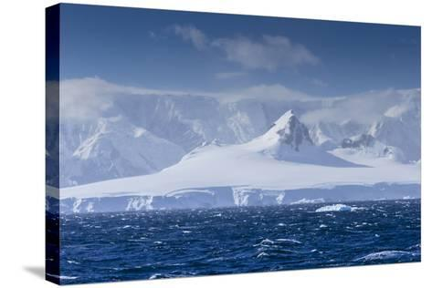 Icebergs and Mountains Near Cuverville Island, Antarctica-Ralph Lee Hopkins-Stretched Canvas Print