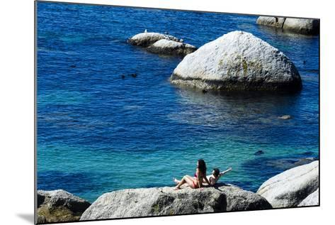 A Couple Sunbathing on a Boulder Above a Clear Blue Sea-Jason Edwards-Mounted Photographic Print