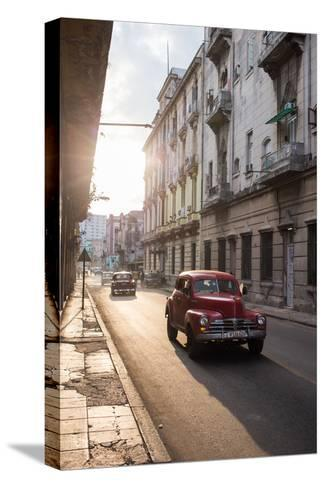 Vintage Cars Drive Down a Street in Havana-Erika Skogg-Stretched Canvas Print