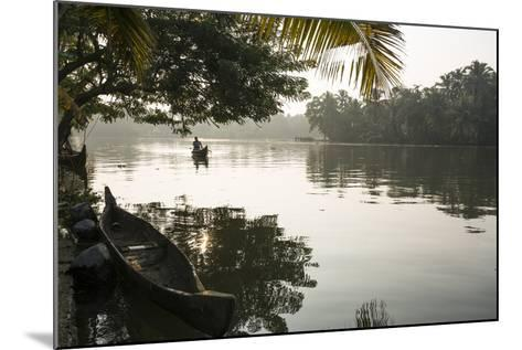 A Man Rows His Canoe Early in the Morning-Kelley Miller-Mounted Photographic Print