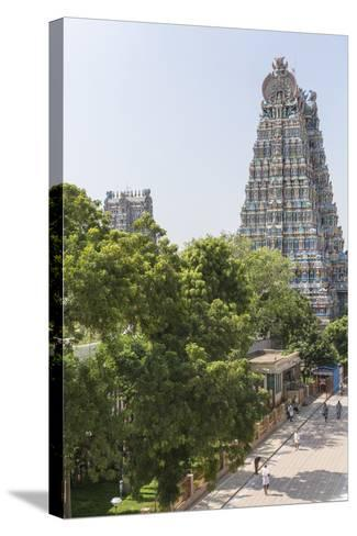 The South Tower of the Meenakshi Amman Temple Rises High Above the Street-Kelley Miller-Stretched Canvas Print